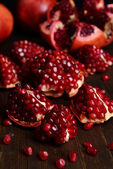 Ripe pomegranates on table close-up — Foto Stock