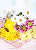 Beautiful chrysanthemum flowers on table on light background  — Stock Photo