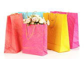 Colorful shopping bags and flowers, isolated on white — Foto Stock