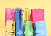 Colorful shopping bags, on color background — Foto Stock