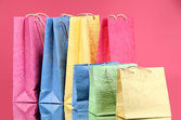 Colorful shopping bags, on color background — Stock Photo