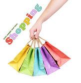 女性の手で、白で隔離されるのカラフルなショッピング バッグ — ストック写真