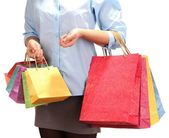 Young woman holding colorful shopping bags in  her hand, isolated on white — Stock Photo