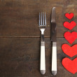 Valentines day dinner with table setting on wooden table close-up — Stock Photo #43205109