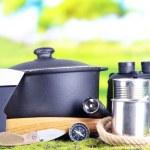Equipment for trekking on green grass, on nature background — Stockfoto