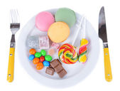 Different sweets on plate isolated on white — Stock Photo