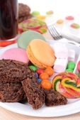 Different sweets on plate on table close-up — Stock Photo