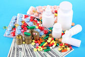 Prescription drugs on money background representing rising health care costs. On color background — Stock Photo