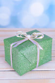 Gift box on table on light background — Stock Photo