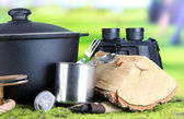 Equipment for trekking on green grass, on nature background — Stock Photo