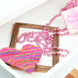 Gift box and beads in open desk drawer close up — Stock Photo #43218851