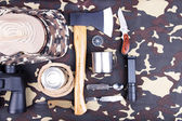Equipment for trekking on camouflage background — Foto de Stock