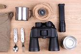 Equipment for trekking on wooden background — Stock Photo