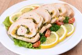 Delicious chicken roll on plate on table close-up — Stock Photo