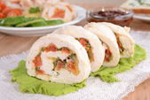 Delicious chicken roll on plate on table close-up — Foto de Stock