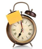 Alarm clock with sticker isolated on white — Stock Photo