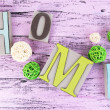 Composition with decorative letters on wooden background — Stockfoto #43224371