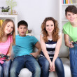Group of young friends playing video games at home — Stock Photo #43225405