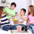 Group of young friends watching television at home — Stock Photo #43225431