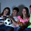 Group of young friends watching television at home of blacking-out — Stock Photo #43225441