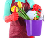Housewife holding bucket with cleaning equipment. Conceptual photo of spring cleaning. Isolated on white — Stock Photo