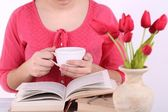 Woman reading book and  drink coffee, close-up — Stock Photo