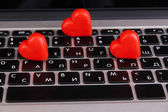 Red hearts on computer keyboard close up — Stock Photo