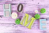 Composition with decorative letters on wooden background — Photo