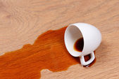 Overturned cup of coffee on floor close-up — Stock Photo