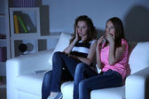 Young girlfriends watching horror movie at home of blacking-out — Foto de Stock