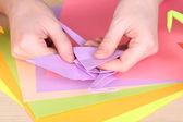Hands making origami crane, close up — Stock Photo