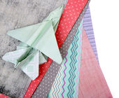 Origami airplane and color papers isolated on white — Stock Photo