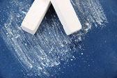 White chalks on school desk — Stock Photo