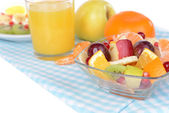 Sweet fresh fruits in bowl on table close-up — Photo