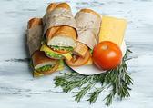 Fresh and tasty sandwich on wooden background — Foto Stock