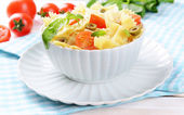 Delicious pasta with tomatoes on plate on table close-up — Foto Stock