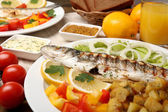 Delicious grilled fish on plate on table close-up — Стоковое фото