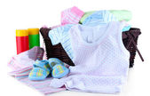 Pile of baby clothes isolated on white — Stok fotoğraf