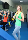 Young beautiful womans in gym — Stock Photo