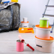 Buckets with paint, wrapped sofa and ladder on wall background. Conceptual photo of repairing works in  room — Stock Photo #43445785