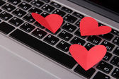 Red hearts on computer keyboard close up — Φωτογραφία Αρχείου