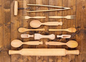 Wooden kitchen utensils on table close-up — Stock Photo