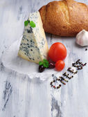 Tasty blue cheese and bread on old wooden table — ストック写真
