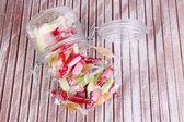 Tasty candies in jar on wooden background — Stock Photo
