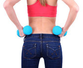 Young beautiful fitness girl exercising with dumbbells, close-up, isolated on white — Stock Photo