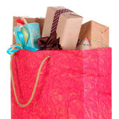 Presents in paper bag isolated on white — Stock Photo