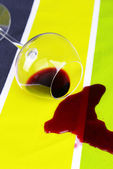 Overturned glass of wine on table close-up — Stock Photo