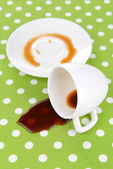 Overturned cup of coffee on table close-up — Stock Photo
