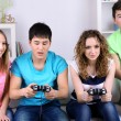 Group of young friends playing video games at home — Stock Photo #43450319