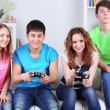Group of young friends playing video games at home — Stock Photo